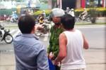 Chủ cây xăng chửi cảnh sát, giải vây xe dù