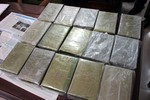 Xét xử đường dây buôn bán 32.000 bánh heroin