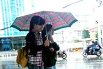 Ảnh: Sài Gòn chợt nắng, chợt mưa