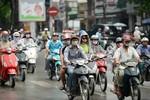 Báo cáo Thủ tướng việc tạm dừng thu phí sử dụng đường bộ xe mô tô