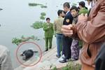 Phát hiện xác chết bụng bị buộc đá, trói chân tay trên sông Đáy