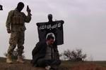 Ảnh: Hành động cực đoan của phiến quân Hồi giáo nổi dậy tại Iraq