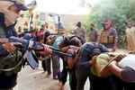 Ảnh: Chiến binh Hồi giáo Iraq công bố cảnh thảm sát các tù nhân