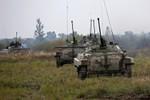 Nga rút quân khỏi biên giới Ukraine, Putin hội đàm với Poroshenko ở Ý