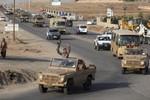 Chiến binh người Kurd mang súng máy, pháo binh tới Kobani