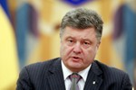 Báo Nga: Poroshenko muốn thoát khỏi gánh nặng Donbass, Putin không cho