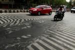 Ảnh: Nóng chảy nhựa đường tại Ấn Độ