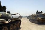 Thành Homs thất thủ, phiến quân bỏ chạy, quân Assad tấn công Aleppo