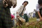 Bà Aung San Suu Kyi lặng lẽ hơn sau chiến thắng