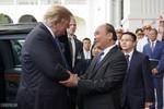 Hình ảnh Thủ tướng Nguyễn Xuân Phúc đón tiếp Tổng thống Hoa Kỳ Donald Trump