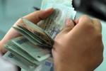 Tăng lương tối thiểu lên 1,15 triệu đồng/tháng từ 1.7.2013