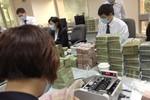 Lương nhân viên ngân hàng Việt giảm mạnh