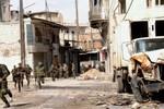 Quân chính phủ Syria tấn công phá hủy 2 xe tải vũ khí của phiến quân