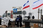 Những tay súng quân phục không phù hiệu tăng cường kiểm soát Crimea