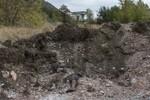 Khoảng 400 thi thể được tìm thấy trong các ngôi mộ tập thể ở Donetsk