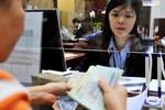 Lương, thưởng nhân viên ngân hàng: Những con số thật sau báo cáo