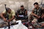 Đối phó với Assad chưa xong, phiến quân Syria lại đụng độ al-Qaeda