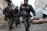 Phiến quân Syria ở Homs đầu hàng, đổi vũ khí hạng nặng lấy thức ăn