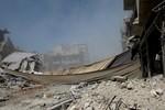 Không quân Syria giáng đòn tấn công mới vào căn cứ phiến quân ở Homs
