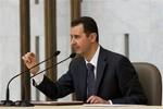Assad: Không quan tâm tới dự thảo nghị quyết của bộ 3 Mỹ, Anh, Pháp