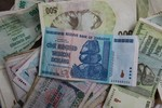 Zimbabwe đổi tiền: 35 nghìn triệu triệu đô la Zimbabwe đổi được 1 USD