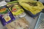Khách Singapore ngụy trang gần 3kg heroin trong đậu phộng và kẹo
