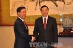 Đồng chí Võ Văn Thưởng gặp Trưởng ban Tuyên truyền Trung ương ĐCS Trung Quốc