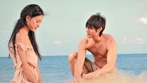 Ngô Thanh Vân sạm đen vì trần mình đóng phim trên bãi biển