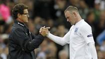 Capello vừa bước chân đi, Rooney đã vội tìm thầy mới
