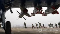 Triều Tiên báo động phòng không, sẵn sàng tấn công căn cứ Hải quân Mỹ